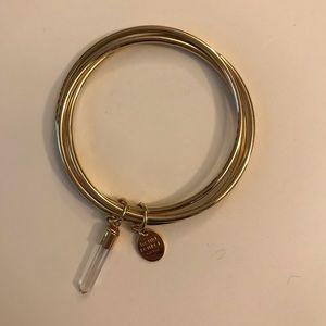 Gold Henri bendel bracelet with crystal charm